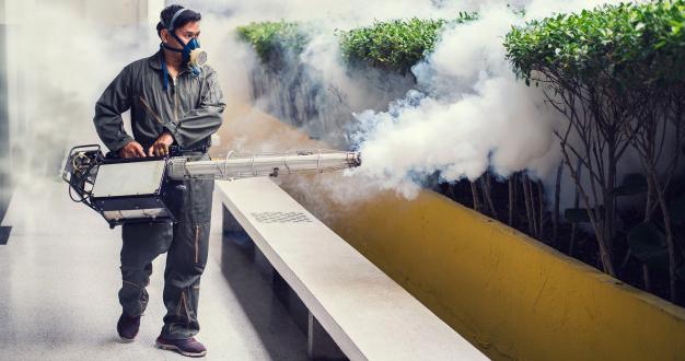 man-fogging-to-eliminate-mosquito_35018-166